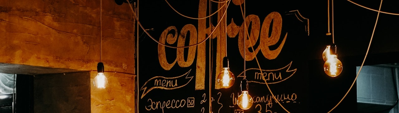 Incandescent bulbs hanging from cafe ceiling